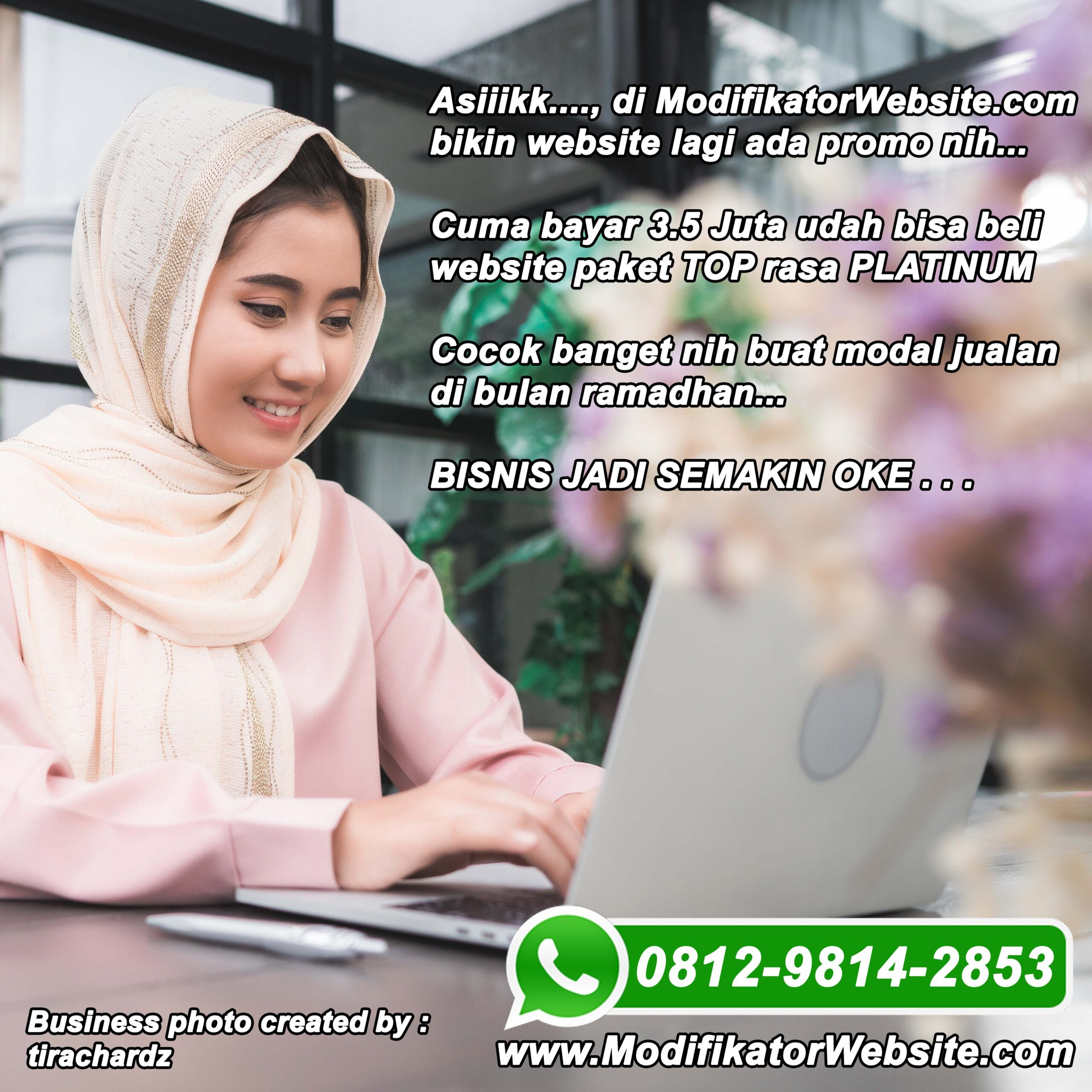 Beautiful young smiling asian muslim woman working on laptop sitting in living room at home. Asian business woman working document finance and calculator in her home office. Enjoying time at home.